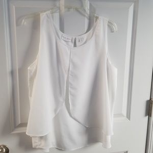 Sleeveless white polyester blouse
